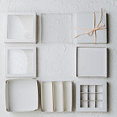 Various possible box parts laid out next to each other on a white surface