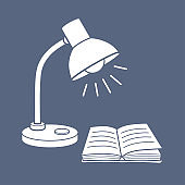 Desk lamp and an open book