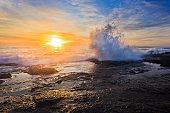 Sea TB On rocks sun splash