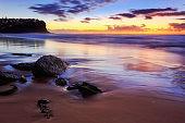 Sea Bung beach dark sand stones