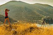 Tourist take photo on nature Mani Greece