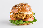Classic Burger with chicken in a bun with sesame tomatoes, lettuce and mustard sauce.