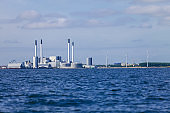 Power plant and wind turbines farm in Baltic Sea, Denmark