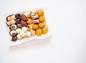 Assortment of pastries and sweets in a tray for dessert or tea time.