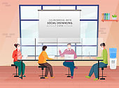 Office Worker Maintaining Social Distance During Work Together At Workplace For Avoid Coronavirus (Covid-19).