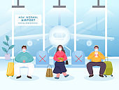Passengers Wear Protective Mask Maintain Social Distance on Seat of Airport Departure to Prevent from Coronavirus.
