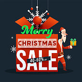 Merry Christmas Sale Poster Design with 40-60% Discount Offer, Snowflakes, Hanging Baubles and Santa Claus Holding a Gift on Dark Grey Background.