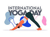 Young Woman Doing Exercise in Adho Mukha Svanasana Pose for International Yoga Day Concept.