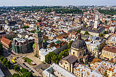 Aerial view of historical old city district of Lviv, Ukraine. Churches, cathedrals, city hall and houses roofs in old lviv.