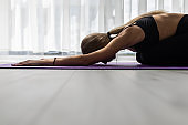 Fitness young woman, make yoga exercises at home