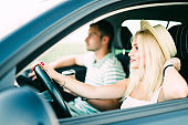 Leisure, road trip, travel, family and people concept, Happy man and woman driving in car
