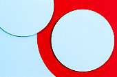 Abstract colored paper texture background. Geometric shapes in red, light blue colors. Top view