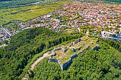 Panoramic view of Ruins of Khust Castle on the mount and mountain valley with Khust city. View from above. Zakarpattia Oblast, Ukraine, Europe