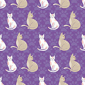 Cats seamless pattern on purple paw prints background