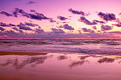 Seascape in the early morning. Purple sunrise over the sea