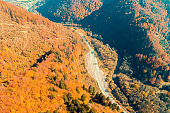 Panoramic aerial view of the mountains with the highway. Beautiful mountain autumn landscape. Carpathian mountains. Ukraine