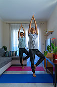 Children doing sport exercises, practicing yoga at home. Sport, healthy lifestyle, active leisure at home