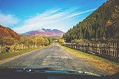 View of the mountain road in autumn. Carpathian mountains. Ukraine