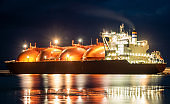 Tanker in the port with lights on, night photography
