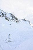 Amateur Winter Sports alpine skiing. Woman snow skier skiing at  ski resort.  High mountain snowy landscape.  Alps mountain Europe,