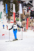 Amateur Winter Sports alpine skiing Giant slalom race. Senior  Man snow skier skiing at  ski resort. High mountain snowy landscape