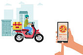Pizza delivery during the coronavirus. Courier on a moped in a face mask with pizza delivery.
