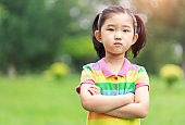 Cute Little Girl Arms Crossed Looking at Camera