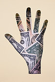 Hand made of paper and American Dollar Banknotes