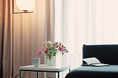 modern home interior with flowers in vase