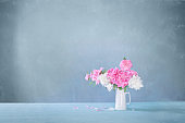 bouquet of pink and white peonies  on background old wall