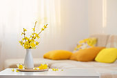 spring flowers in vase on modern interior