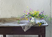 summer wild flowers on old wooden table