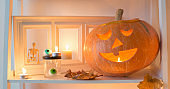 halloween pumpkins with candles on wooden table