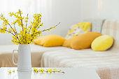 spring yellow flowers in vase on modern interior