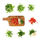 Chopped paprika or red sweet pepper cuts on wooden background