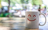 Drink hot coffee in white cup on wooden table .Freshness in the morning or great aroma and energy concept.