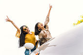 Two young woman happy on road trip. Travel with best friend.