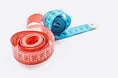 centimeter ribbon pink and blue on a white background. The concept of weight loss and a healthy lifestyle.