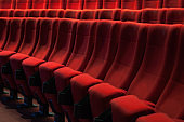 Cinema auditorium with one reserved seat