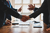 Handshake. Meeting of business people and working cooperation in the organization.