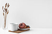 Mug and donuts cakes on a white background. Confectionery, coffee shop. Copy space, mock up.