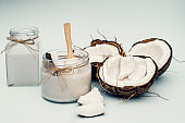 Parts of coconut on a colored background. Close up. Fresh ripe coconut broken into pieces. Coconut oil.