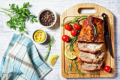 Sunday roasted pork tenderloin, juicy and succulent oven-baked piece of meat rubbed with mustard and spices