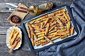 crunchy zucchini sticks breaded with panko breadcrumbs, parmesan cheese, spices