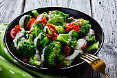 broccoli tomato salad with crispy fried bacon and cheese yogurt dressing