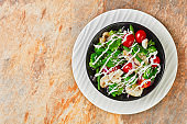 salad of broccoli florets, steamed green beans, champignons, tomatoes, red onions topped with yogurt dressing