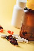 Bottle and Pills on yellow Background. Medicine Healthcare Pharmacy Concept. Coronavirus.