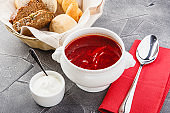 Ukrainian and Russian national red borsch with sour cream and herbs.