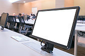 Business executive people group sitting at conference table with white blank mockup tv screen on table in meeting room.