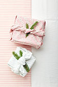Christmas eco-friendly gift wrap in traditional japanese furoshiki style, eco-friendly gift wrap and Zero Wast concept